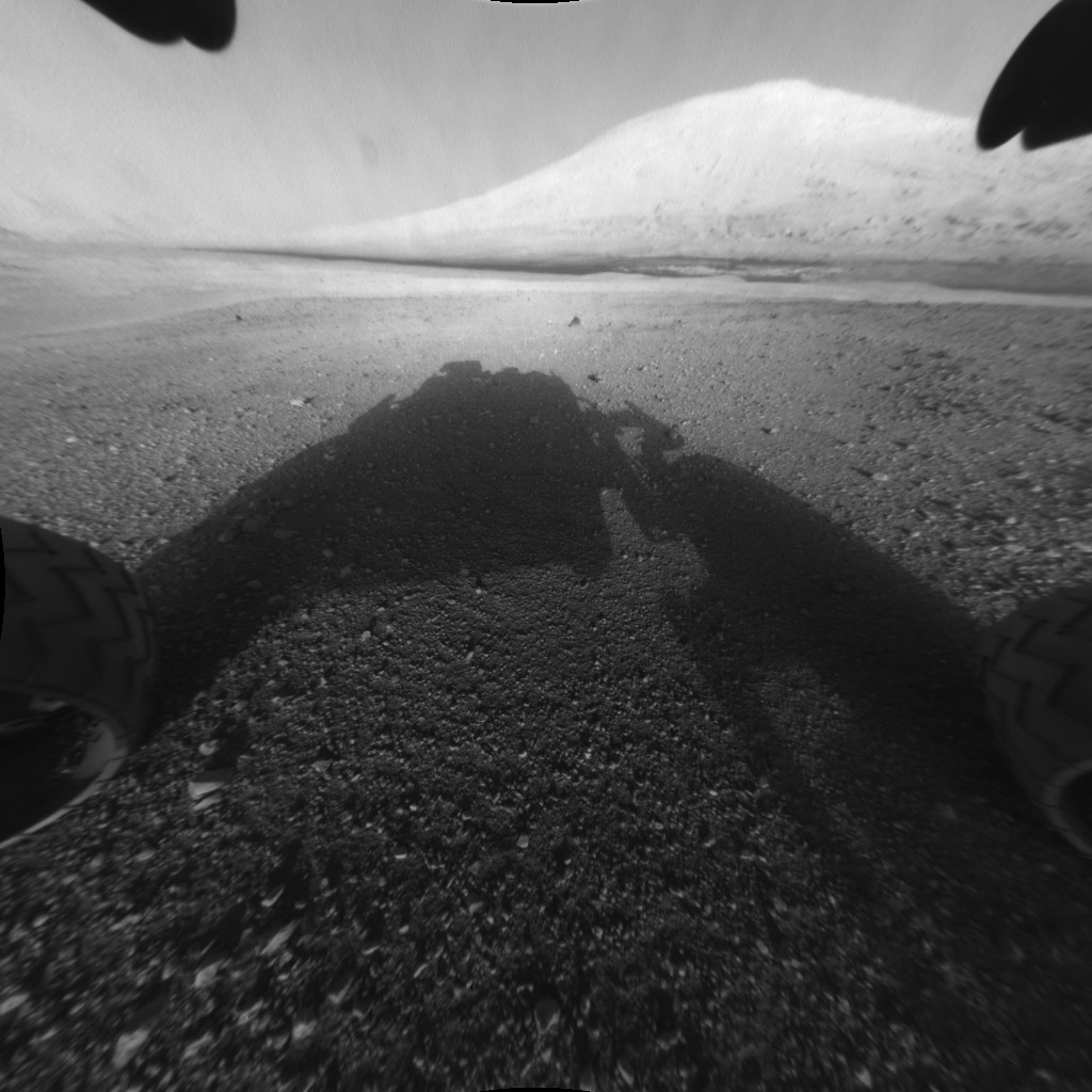 Good morning, Mars. Part self-portrait, part landscape, this photo captures Curiosity's shadow and the features of Gale crater beyond.