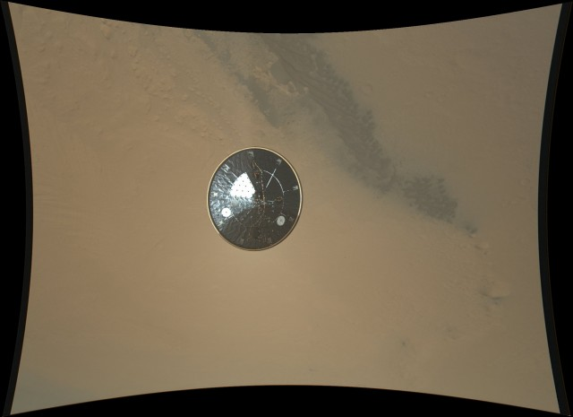 The heat shield, its job complete, is set loose into the Martian atmosphere.