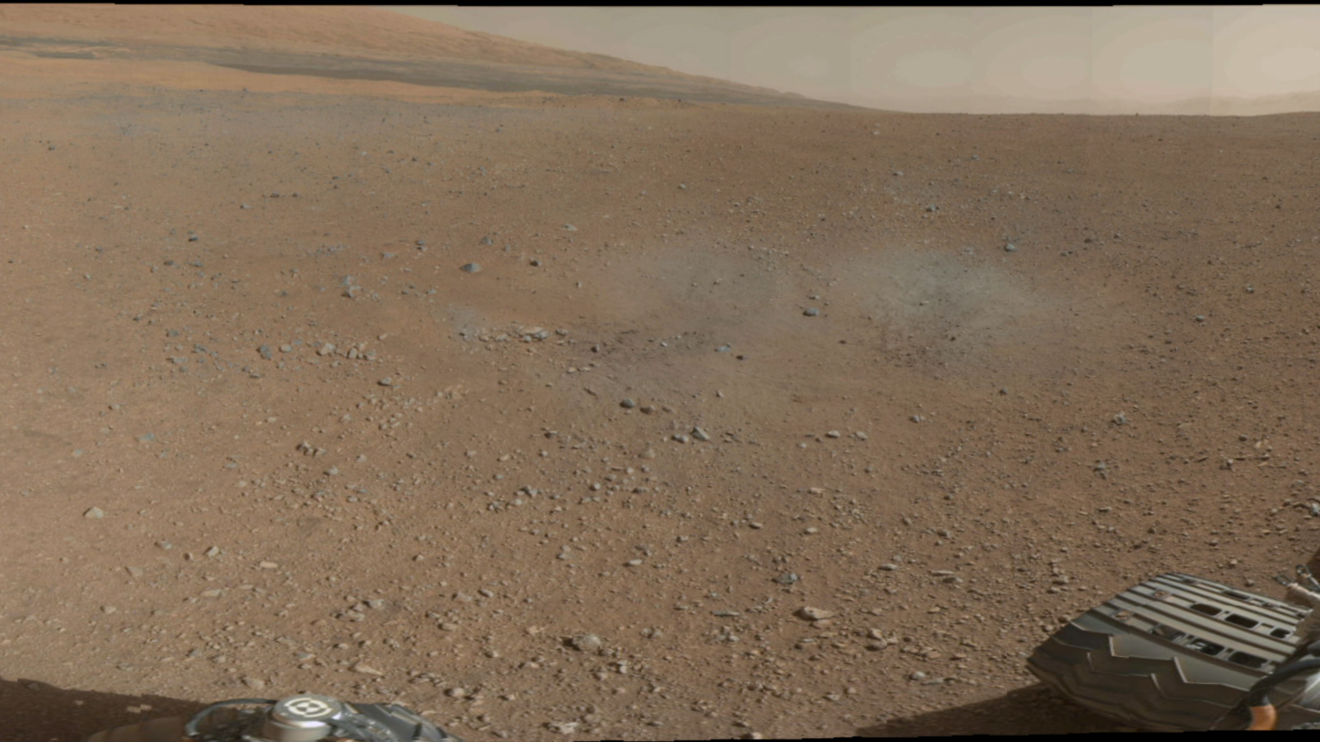 Curiosity does color, too, showing off the Red Planet's surface.