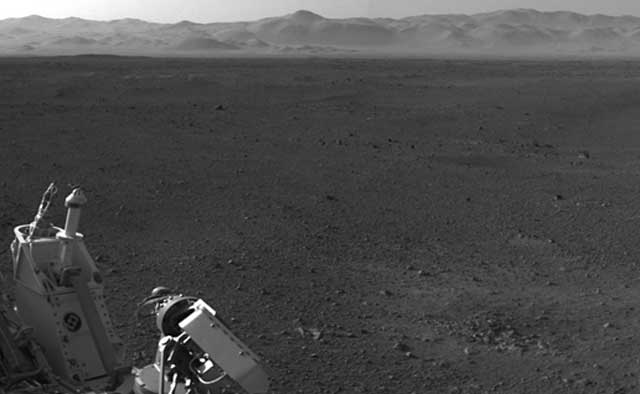 Curiosity's low-gain and high-gain antennas in this view looking northeast at the rim of Gale Crater.