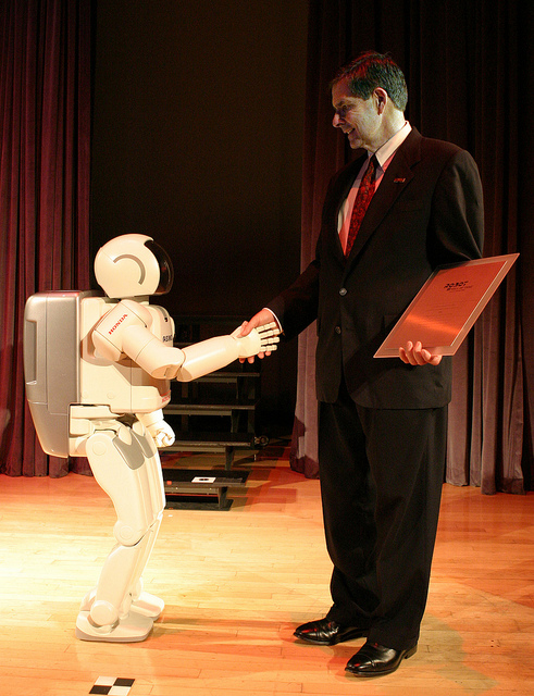 ASIMO accepts its induction into the Robot Hall of Fame in 2004.