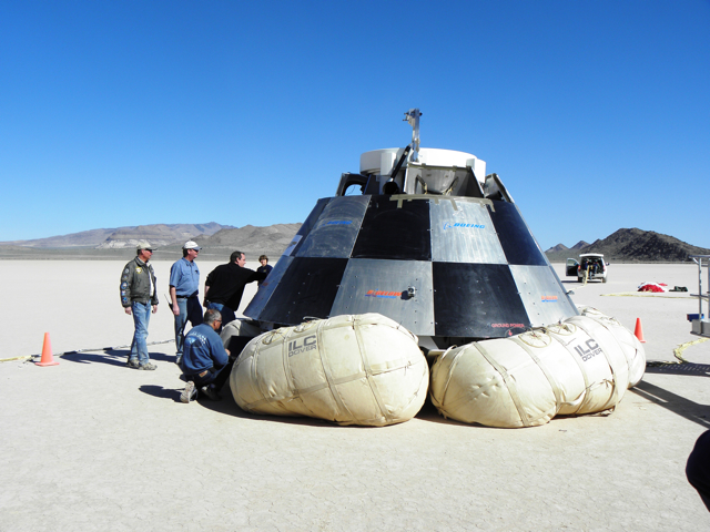 The Boeing CST-100 just after its successful drop test at Delamar Dry Lake, Nevada