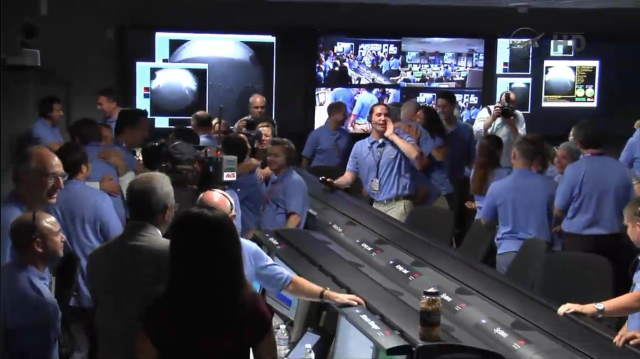 Ecstasy breaks out in the JPL Mission Control Room.