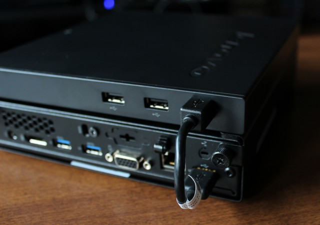 The optical drive plugs into the M92p's USB 2.0 port with the included short USB cable, and provides two extra USB 2.0 ports to the computer.