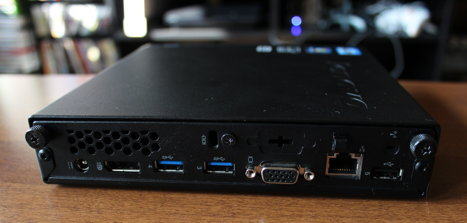 The M92p's back features VGA and DisplayPort outputs, a gigabit Ethernet port, two USB 3.0 ports, one USB 2.0 port, a jack for the computer's external power adapter, a Kensington lock slot, and a spot where the wireless antenna would be if our unit included one.