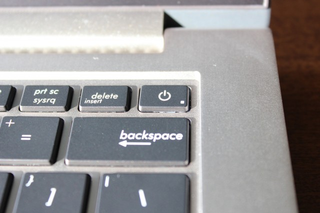 The UX31A's power button is nestled in the upper-right corner of the keyboard.