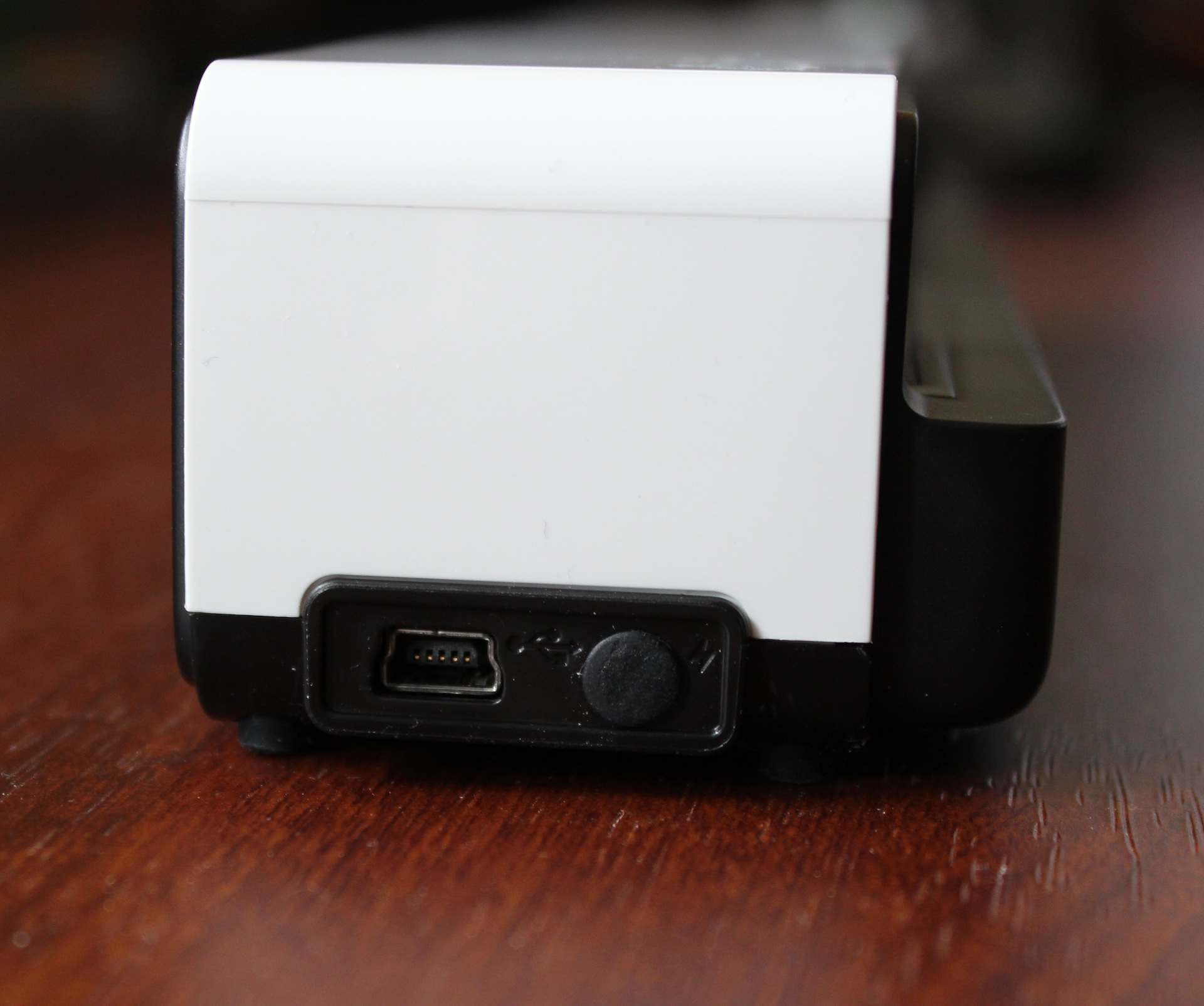 The Go keeps its mini USB port on its left side. The rubber stopper to its right protects the jack for the optional international power adapter accessory.