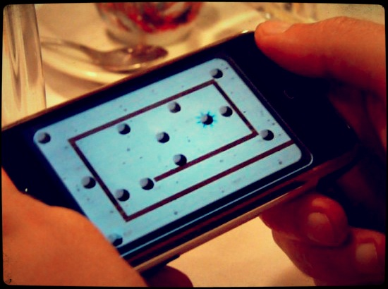 The iPhone makes it easy to get in a quick game while waiting for dinner to be served.