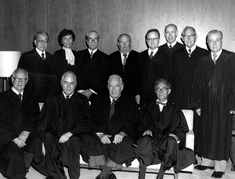 Judges of the United States Court of Appeals for the Federal Circuit on October 1, 1982, the day they were sworn in by Chief Justice Burger. In the front row are Circuit Judge Giles S. Rich, Chief Judge Howard T. Markey, Chief Justice Warren E. Burger, and Circuit Judge Daniel M. Friedman.