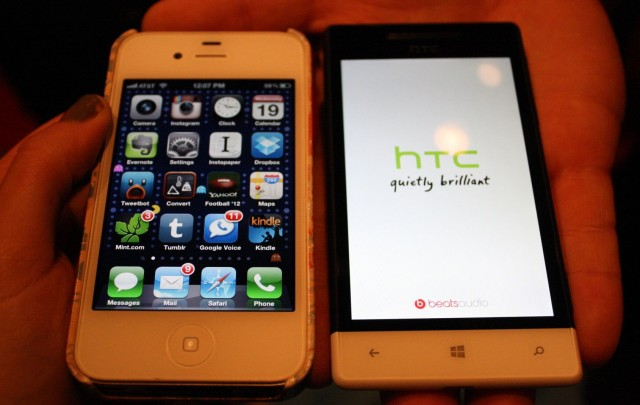 Left, an iPhone 4S in a case; right, an HTC 8S