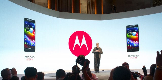 Motorola Senior VP of Product Management Rick Osterloh with images of the Droid Razr M