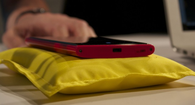 A red Lumia 920 on a charging pillow.