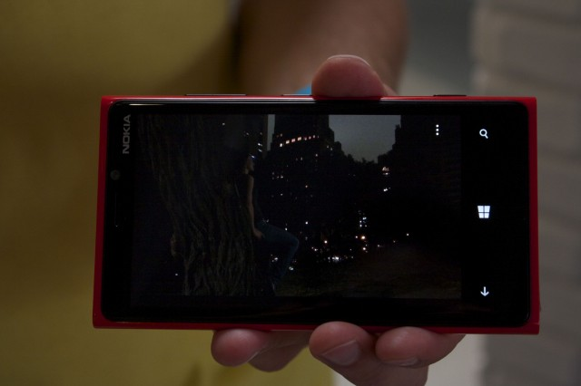 "A ""competing smartphone"" in a low light scenario, no flash"