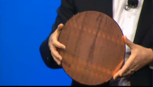 Intel Chief Technology Officer Justin Rattner holds a wafer of Rosepoint system-on-a-chip dies. Each die has two Atom cores and a full WiFi transceiver.