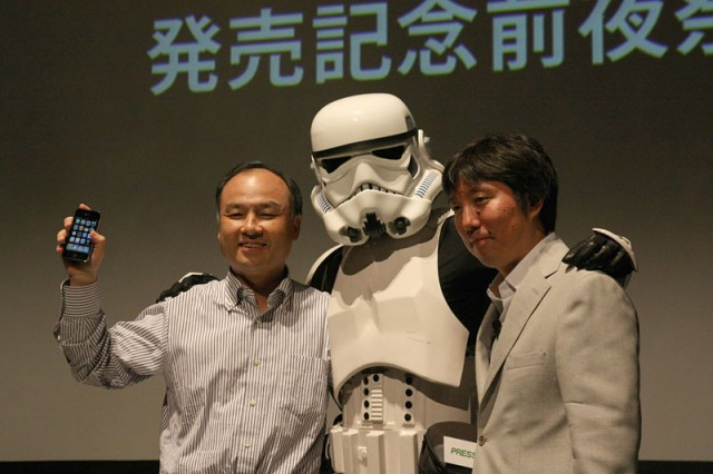 Masayoshi Son (left), poses with a Storm Trooper at Sprint owner SoftBank's launch of the iPhone 3GS in 2009.