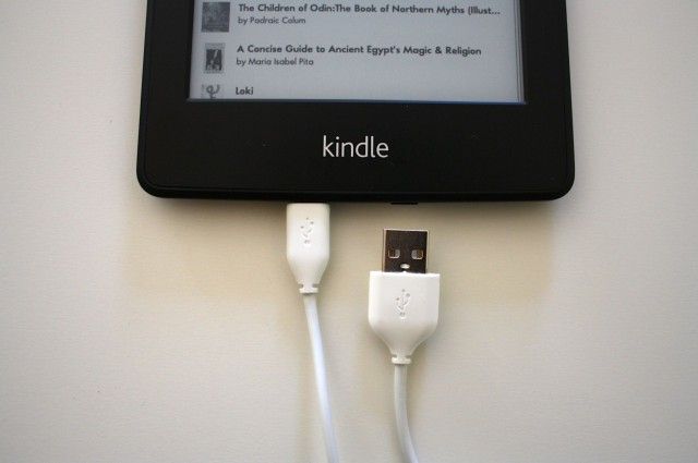 No wall charger included in this version of the Kindle.