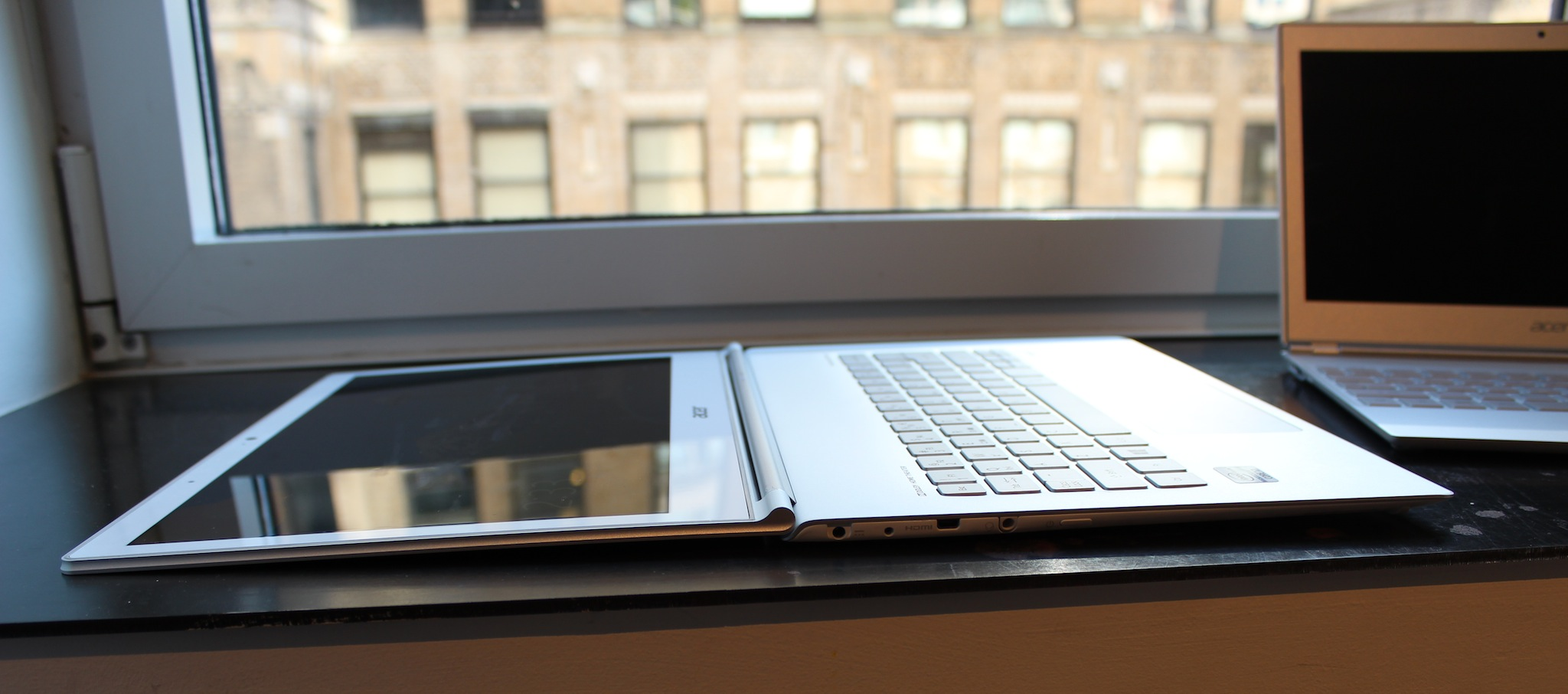 "Both laptops have firm ""dual torque"" hinges, and the 13"" model will fold 180 degrees to lie flat on your desk."