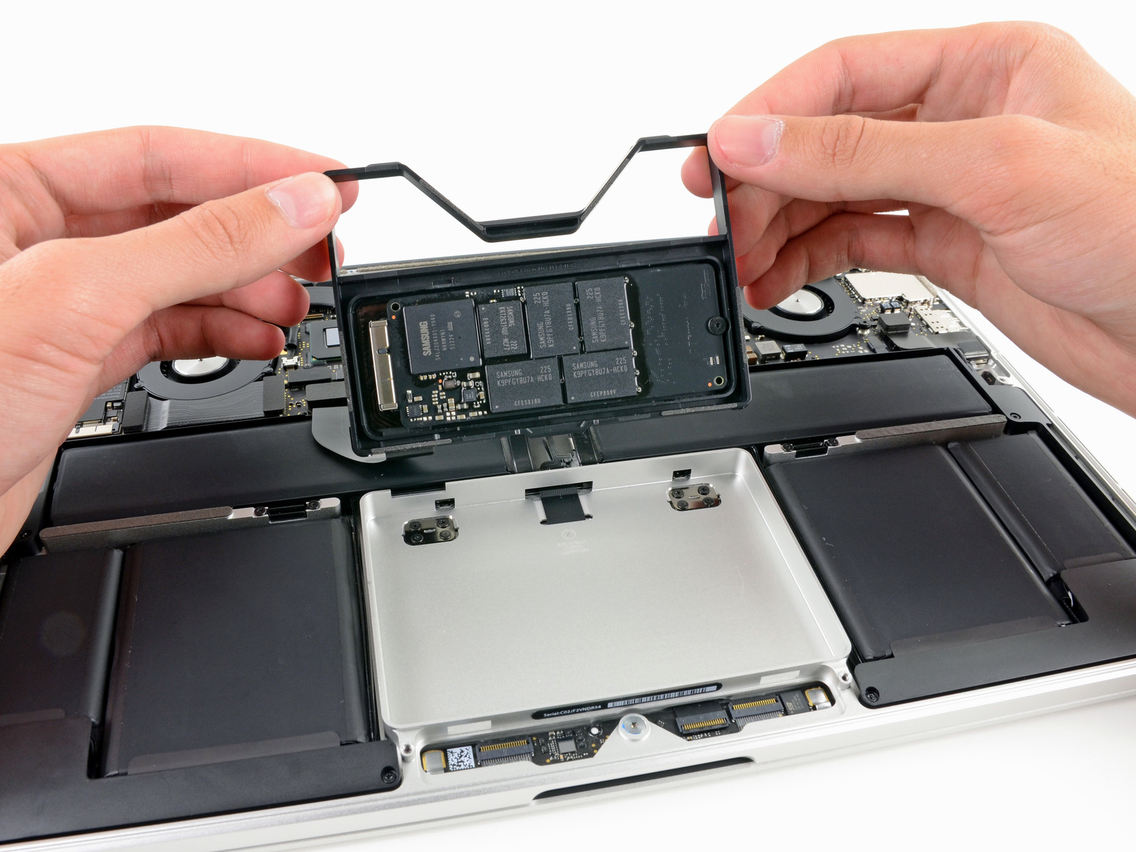 There's plenty of room underneath the trackpad for a much larger SSD module.