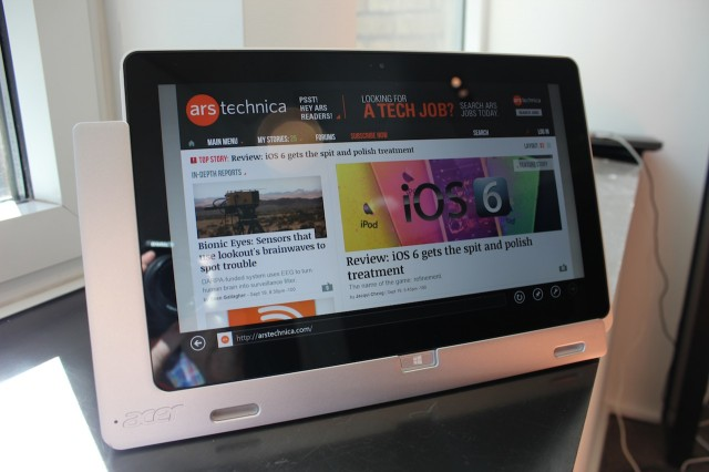 The Acer Iconia W700 tablet in its docking cradle.