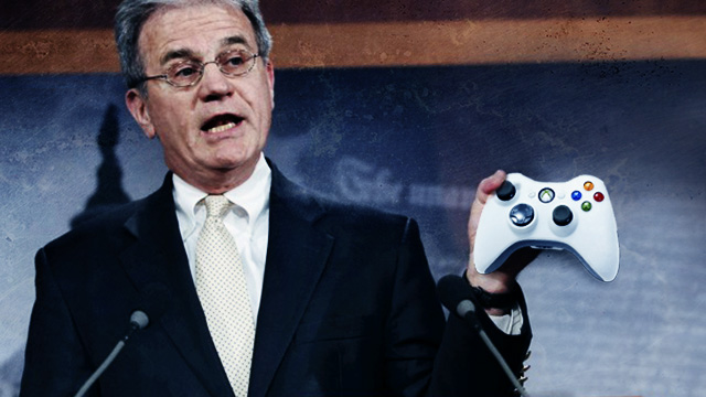 Senator Tom Coburn, completely unaware someone has handed him an Xbox controller (image remixed by Aurich Lawson).