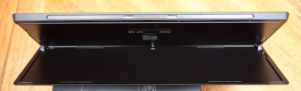 The Cover Port on the bottom of the Surface.