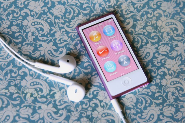 """The iPod nano still uses circular icons for its """"apps"""" arranged on an iOS-like home screen."""