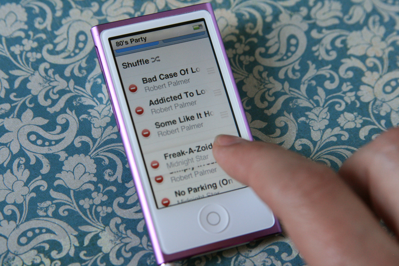 The iPod nano's touchscreen works just as you might expect, including tapping and dragging to re-arrange playlists.