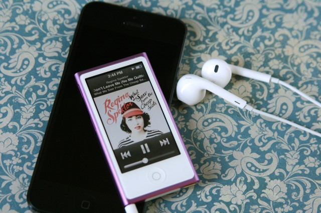 The new iPod nano looks like a mini iPod touch, and is still quite small (seen here with an iPhone 5) despite its larger 2.5-inch touchscreen.
