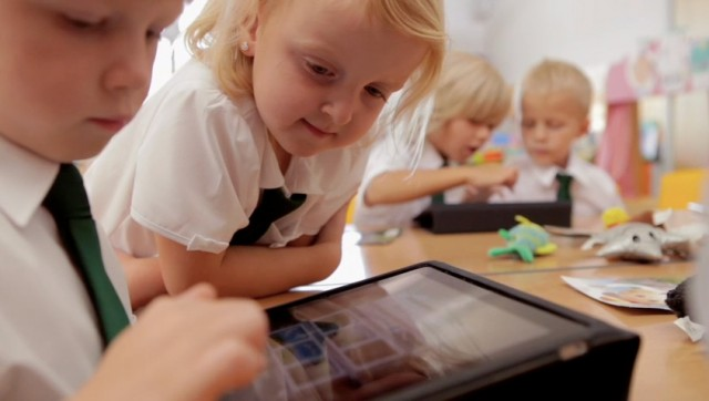 Students at UK public school Flitch Green Academy use iPads to enhance classroom activities.