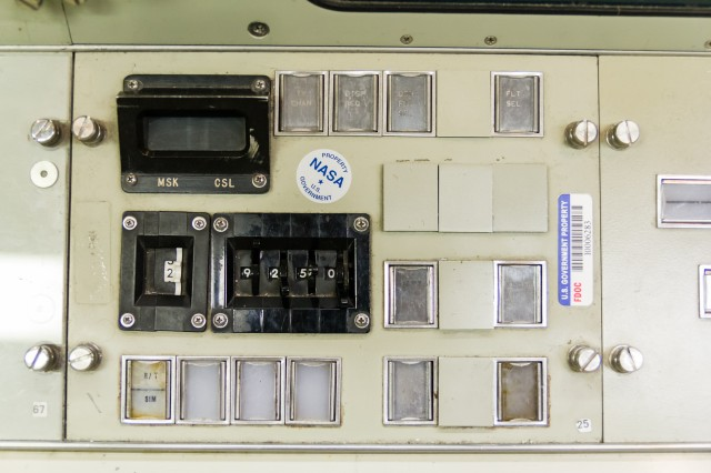 "A typical manual display selection panel. Controllers could select different display ""channels"" for their monitors using the black numerical rotary dials, and also change the displays on the MOCR's large front screens."