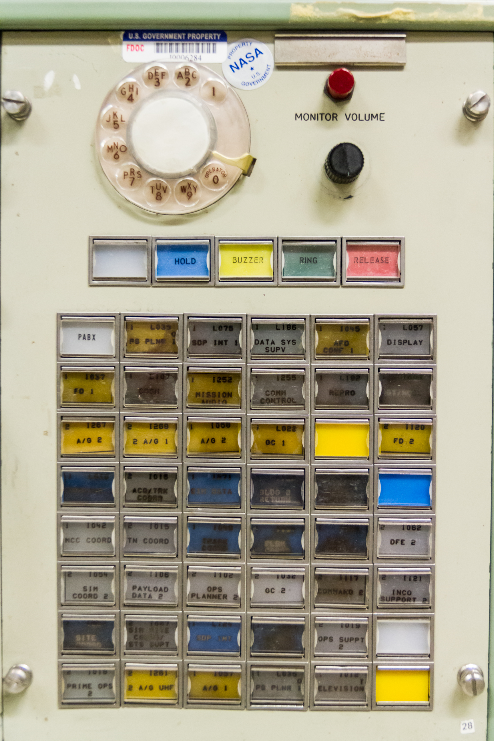 A typical PABX (Private Automatic Branch Exchange) communications panel. The labeling and layout on this panel is from the Shuttle era. Different buttons in the main control represent different communications loops or outside phone lines which could be monitored or spoken on.