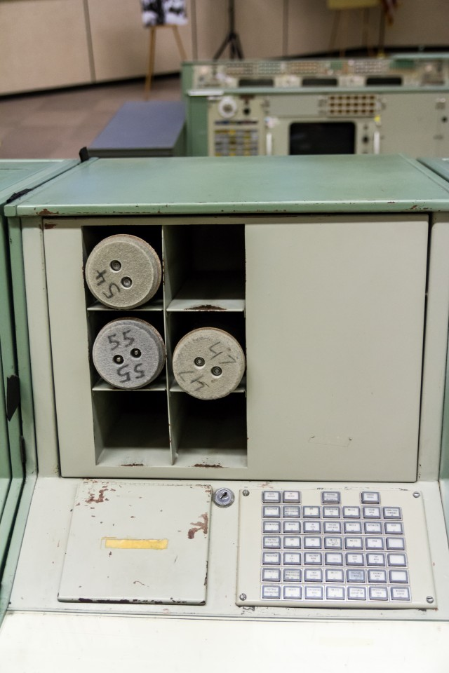 "A typical pneumatic tube (""p-tube"") station, showing carriers, hatch, and control panel."