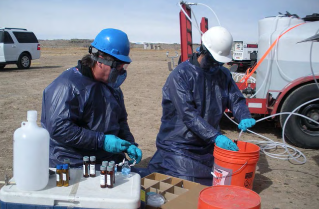EPA workers in protective gear obtain samples for studying groundwater contamination in Pavillion, Wyoming.