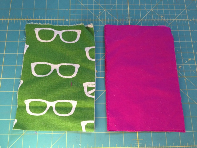 The fabric I've cut for my Kindle Fire sleeve. Left is the outer fabric and right is the lining.