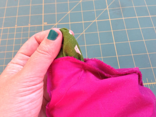 Pull the outer fabric through the hole you left in the lining until the whole thing gets turned right-side-out.
