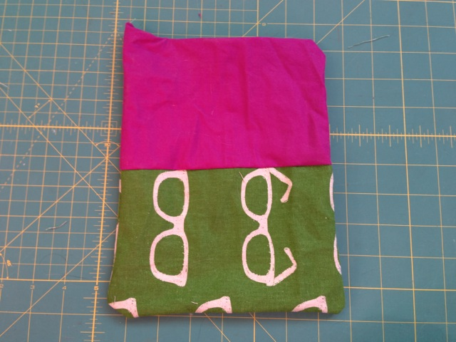 This is what it will look like after you turn it all right-side-out. Then, tuck the lining (for me, the pink part) inside of the outer fabric.