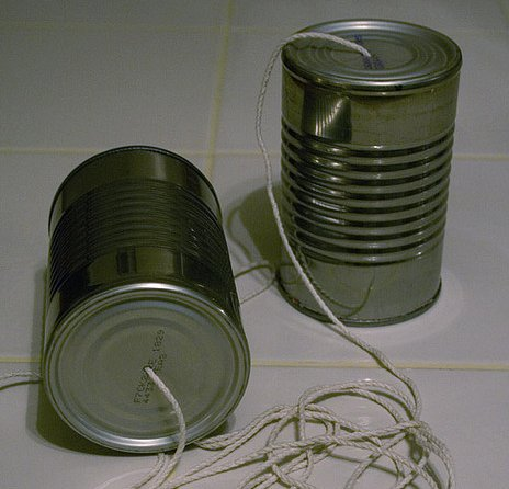 Communication often requires bypassing entanglement, as with tin-can telephones.