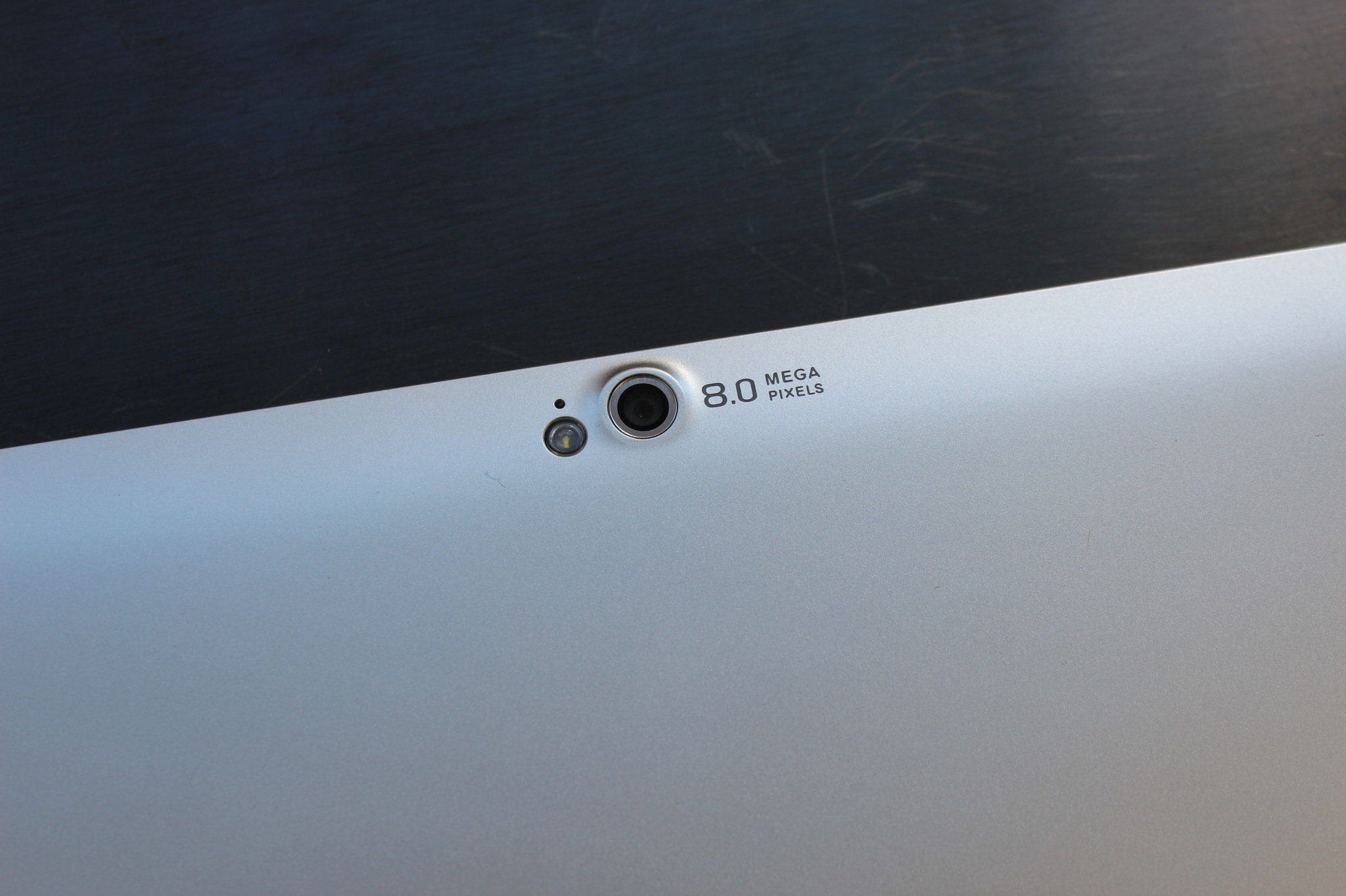 The 8 megapixel camera on the reverse side of the W510. The tablet also includes a 2 megapixel camera on the front.