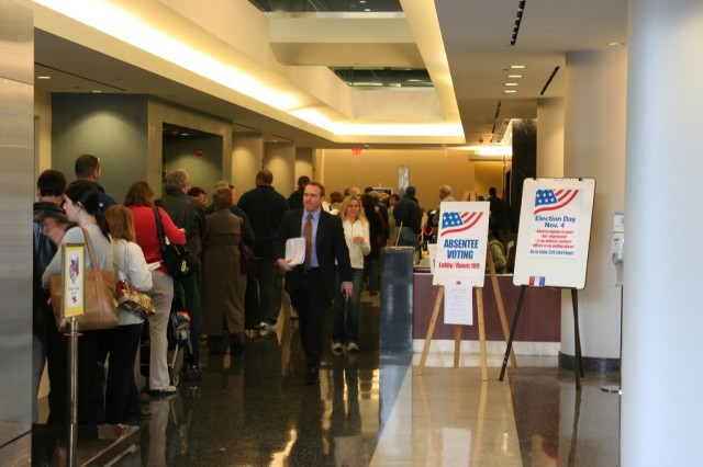Voters stand in an early voting line in Arlington, VA.