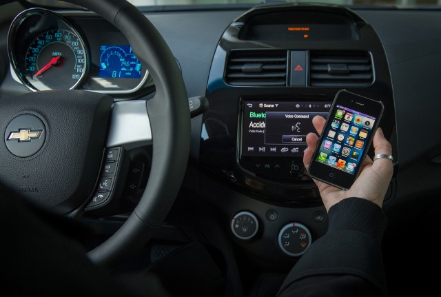 Chevy's 2013 Spark and Sonic compact cars will let drivers ask Siri to perform simple tasks while keeping their eyes on the road and hands on the wheel.