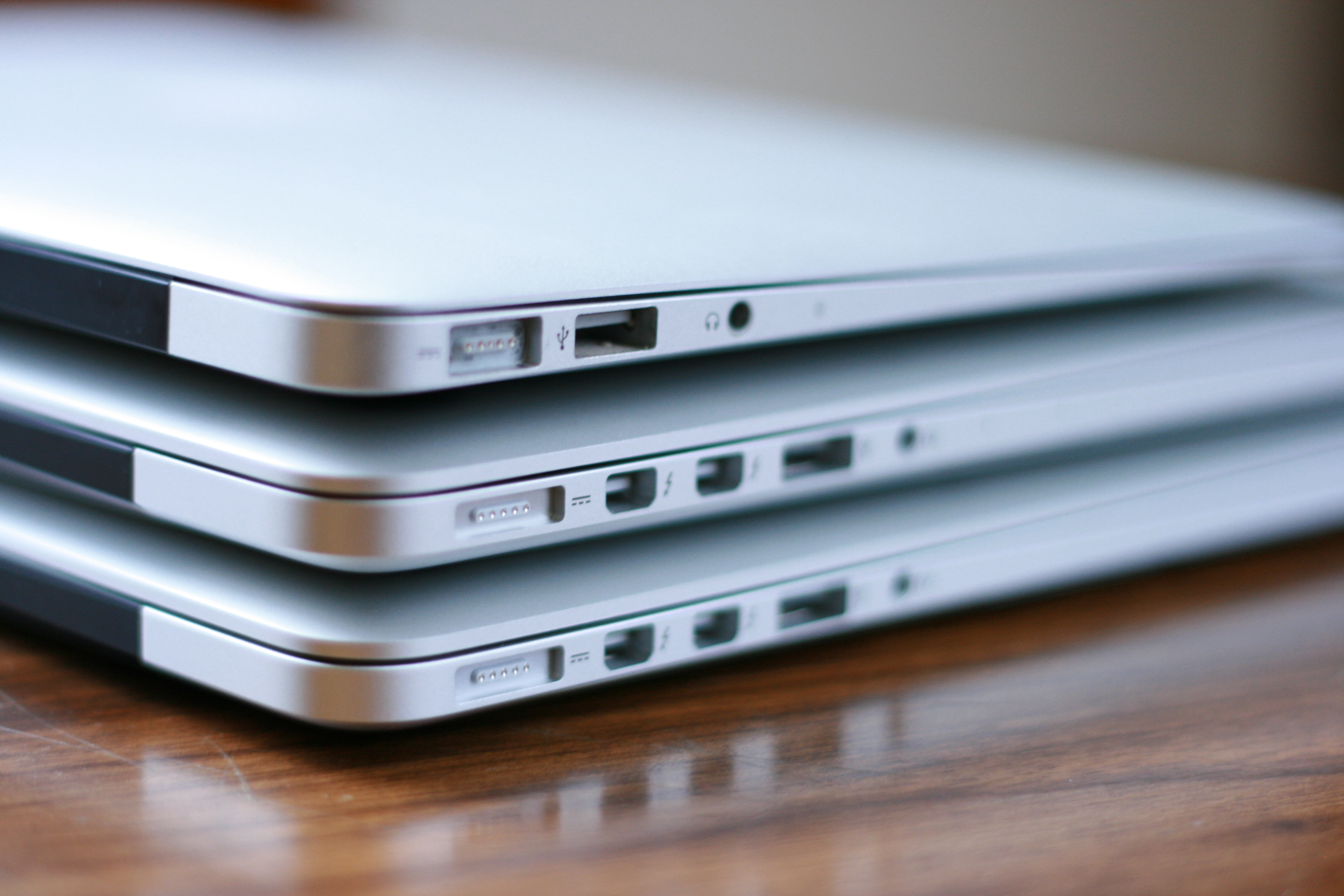 "Another comparison of (bottom to top) 15"" Retina MacBook Pro, 13"" Retina MacBook Pro, and 11"" MacBook Air."