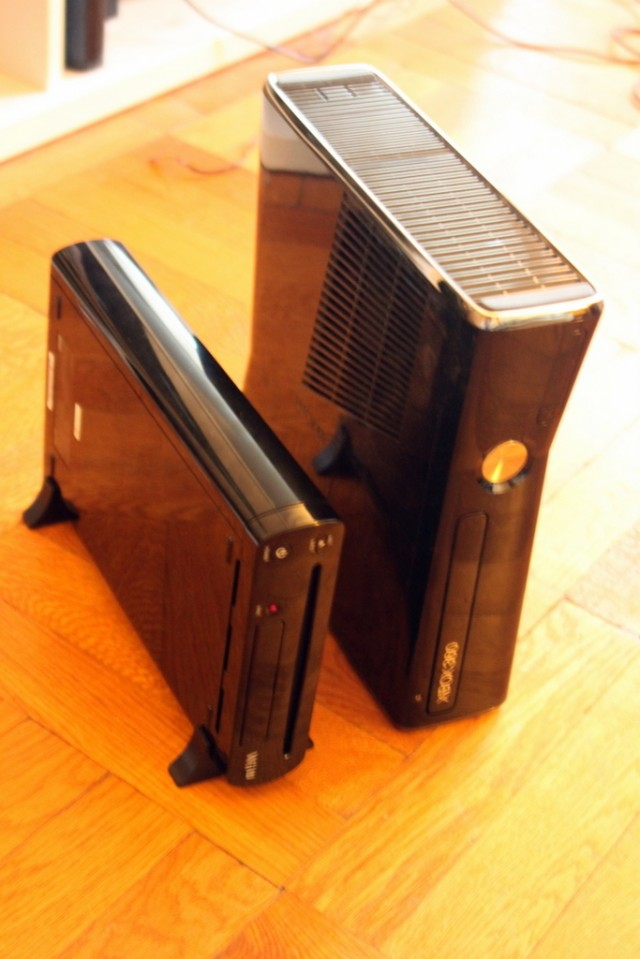 The Wii U and the Xbox 360 Slim (the Wii U is the small one).