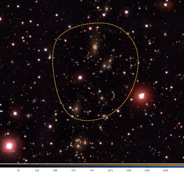 The dotted line encloses a galaxy cluster identified in a survey of the southern sky. Clusters provide a potentially sensitive test of the properties of dark energy, the unknown influence driving cosmic acceleration.