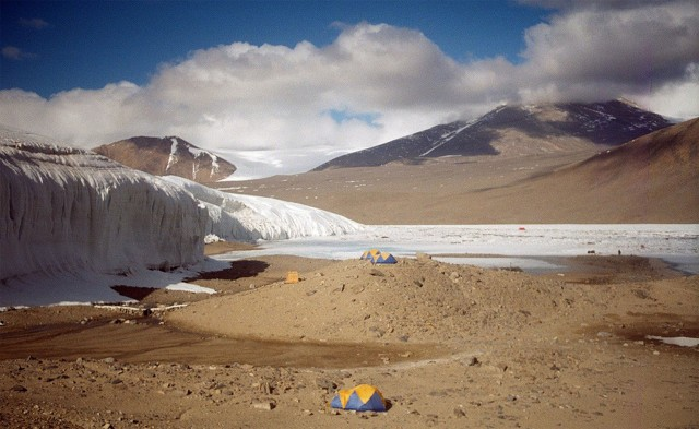 One of the glaciers in the McMurdo Dry Valleys dwarfs the tents of researchers who have travelled to study it.