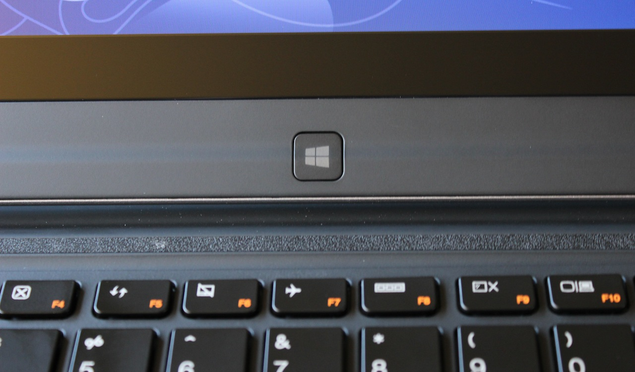 A Windows button is located under the LCD panel, for use when the laptop is in tablet mode.
