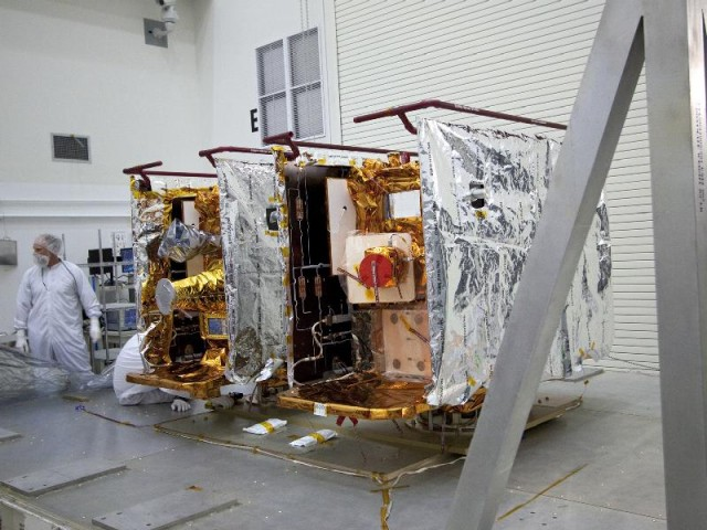 The twin GRAIL spacecraft sitting side-by-side in the cleanroom, in preparation for their mission to measure the composition of the Moon's interior.