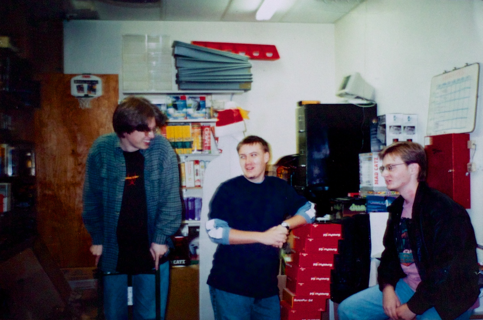 The author and his buddies Matt and Steve, hanging out in the Babbage's back room circa 1997. Facing the wall behind Matt is the Darth Vader cardboard cutout.