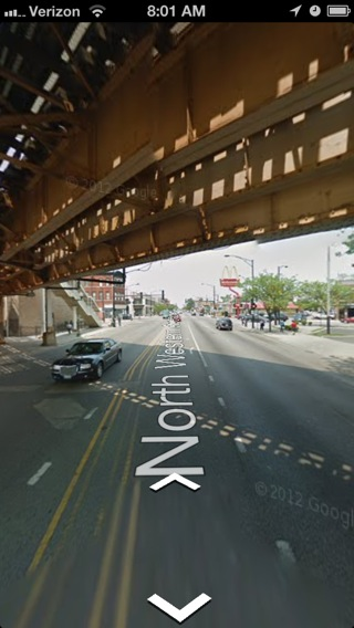 You can drag your finger around the screen to turn and look at other things in Street View.