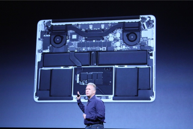 Apple's Phil Schiller showing off the internals of a retina MacBook Pro in San Jose on October 23, 2012.