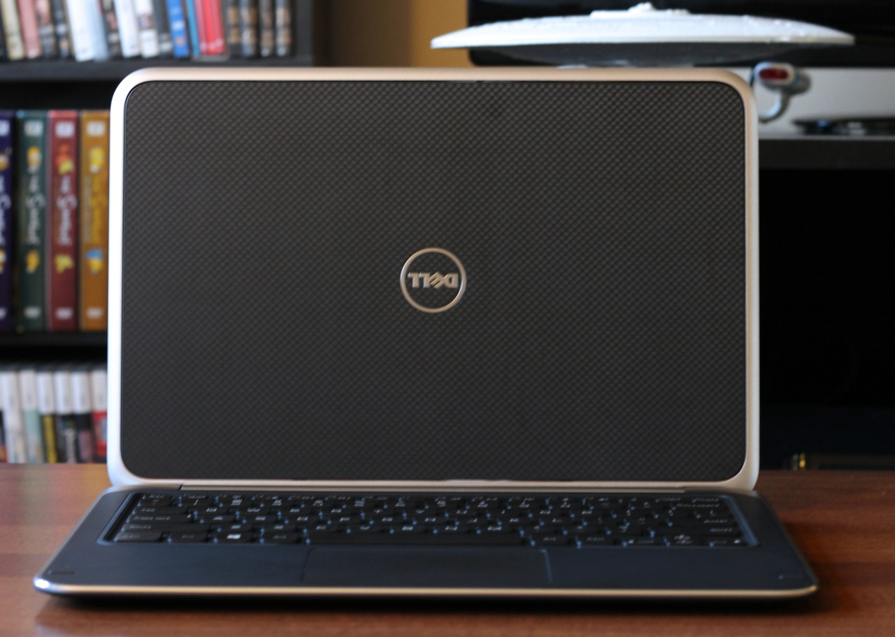 The laptop's lid (shown here flipped) uses a slightly rubberized checkerboard texture.
